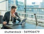 young businessman in suit... | Shutterstock . vector #569906479