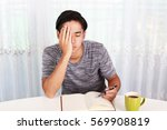 tired asian man | Shutterstock . vector #569908819