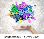 hand holding colorful brain... | Shutterstock . vector #569912524