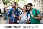 tourist group of  friends... | Shutterstock . vector #569918371