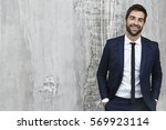 laughing suit guy looking at... | Shutterstock . vector #569923114