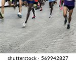 legs of runners  racing towards ... | Shutterstock . vector #569942827