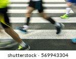 runners going over zebra... | Shutterstock . vector #569943304