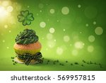 cupcake with clover cakepick on ... | Shutterstock . vector #569957815