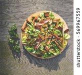 fresh ceaser salad on wooden... | Shutterstock . vector #569967559