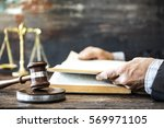 man reading book with gavel and ... | Shutterstock . vector #569971105