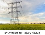 power pylons and high voltage...   Shutterstock . vector #569978335