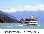 Passenger ship with swiss flag on the lake, Jungfrau mountains on the background, Thunersee lake, Thun, Bern canton, Switzerland,Europe  - stock photo