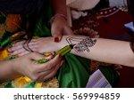 realization of henna tattoo on... | Shutterstock . vector #569994859