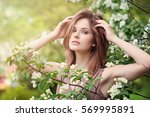 beautiful woman with spring... | Shutterstock . vector #569995891