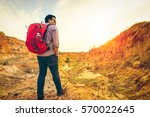 young man traveler with backpack | Shutterstock . vector #570022645