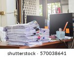 pile of papers on the desk | Shutterstock . vector #570038641