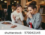 two best friends girls drinking ... | Shutterstock . vector #570042145