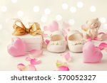 close up of baby shoes and gift ... | Shutterstock . vector #570052327