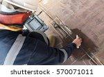 steel plate inspection by... | Shutterstock . vector #570071011