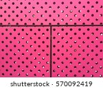 pink walls with holes