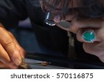 male jeweler looking through a... | Shutterstock . vector #570116875