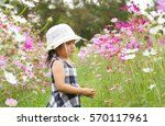 asian female girl playing in... | Shutterstock . vector #570117961