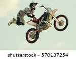 Motocross jump biker acrobatic jump at the trial show - stock photo
