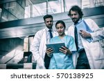 doctors and nurse looking at... | Shutterstock . vector #570138925