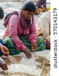 Small photo of SIRA, KARNATAKA/INDIA - JANUARY 17, 2017: Indian women labor sorting and cleaning watermelon seeds