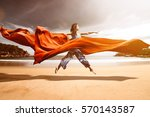woman at the beach with red... | Shutterstock . vector #570143587