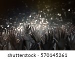 hands in the air | Shutterstock . vector #570145261
