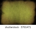 close-up of rough material background stained on the edges - stock photo