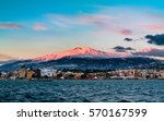 first ray of sun on etna  | Shutterstock . vector #570167599