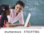 Teacher And Girl At Laptop ...