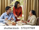woman serves dinner to man and... | Shutterstock . vector #570197989