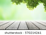 empty wooden table with party... | Shutterstock . vector #570214261