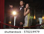 young couple standing behind... | Shutterstock . vector #570219979