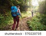 two hikers walking along a...   Shutterstock . vector #570220735