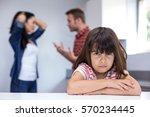 sad girl hearing her parents...   Shutterstock . vector #570234445