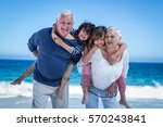 happy grandparents giving piggy ... | Shutterstock . vector #570243841