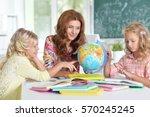 teacher with two girls  | Shutterstock . vector #570245245