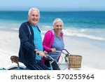 mature couple riding bicycles... | Shutterstock . vector #570255964