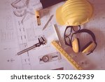 construction plans with helmet... | Shutterstock . vector #570262939