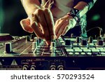 dj playing music at mixer... | Shutterstock . vector #570293524