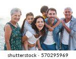 happy family posing at the... | Shutterstock . vector #570295969