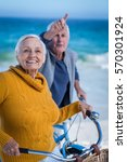 senior couple with bikes... | Shutterstock . vector #570301924