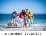 Happy Family With Their Dog At...
