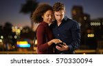 young romantic couple using... | Shutterstock . vector #570330094
