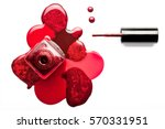 Fine art beauty concept of red and metallic coppery nail varnish puddled artistically around an open bottle with the applicator lying alongside viewed from overhead isolated on white with copy space - stock photo