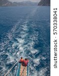 Small photo of Two people on the boat ladder. The boat moves in the Aegean Sea