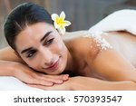 woman lying on massage table... | Shutterstock . vector #570393547
