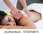 woman enjoying a salt scrub...   Shutterstock . vector #570393871