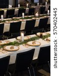 wedding reception tables with...   Shutterstock . vector #570402445