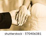 wedding man holding woman hand | Shutterstock . vector #570406381